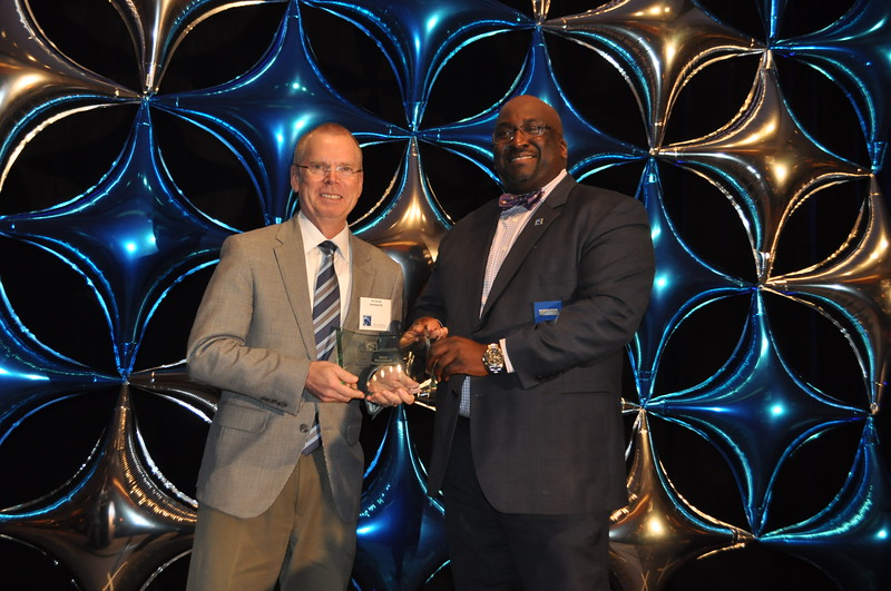 BCID's executive director, Jim Durrett is presented with the 2016 BBA Beautification award by 2017 BBA president, Barry Hundley.