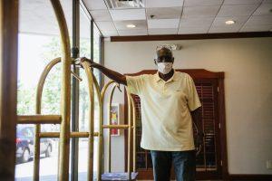 Man standing in hotel lobby